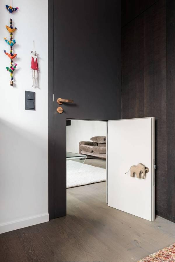 3-whimsical-doors-drawers-cubby-creations-karhard-architektur-4-door.jpg