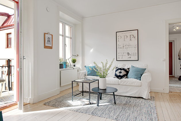 casually-comfortable-decor-driven-apartment-sweden-couch.jpg