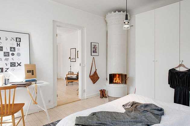casually-comfortable-decor-driven-apartment-sweden-fireplace.jpg
