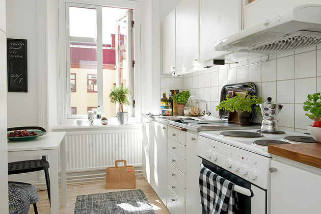 casually-comfortable-decor-driven-apartment-sweden-kitchen-counters.jpg