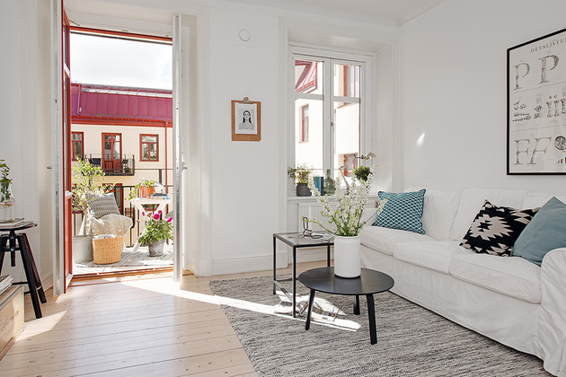 casually-comfortable-decor-driven-apartment-sweden-living-room-window.jpg