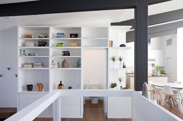 cupertino-cubby-filled-hundreds-shelves-bathroom-entrance.jpg