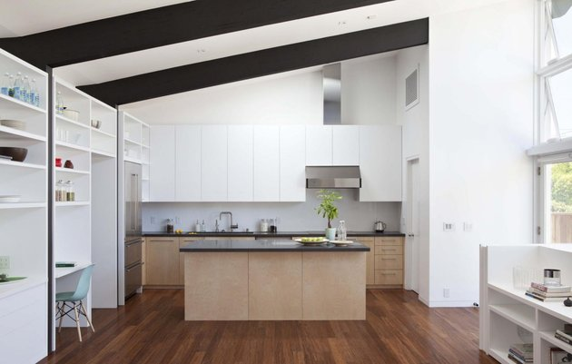 cupertino-cubby-filled-hundreds-shelves-kitchen-from-living-room.jpg