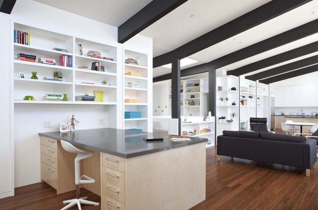 cupertino-cubby-filled-hundreds-shelves-living-room-desk.jpg