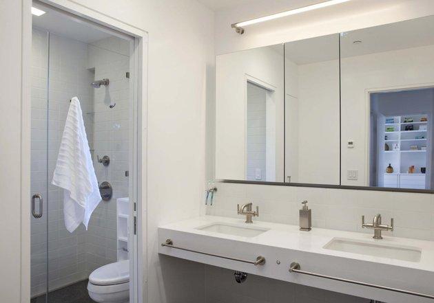 cupertino-cubby-filled-hundreds-shelves-master-bath-sink.jpg
