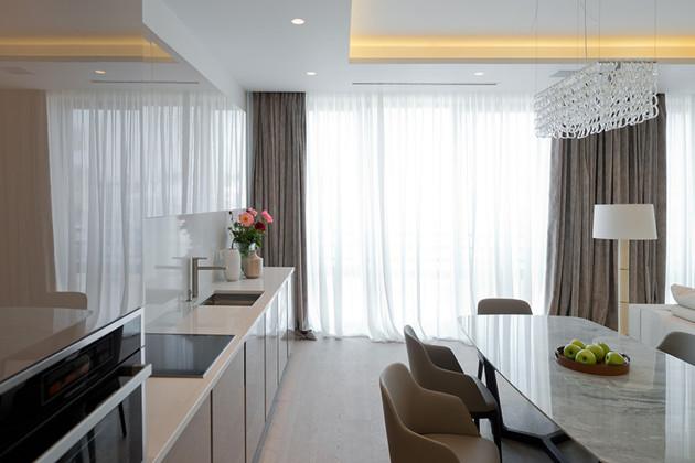 lighting-details-create-drama-modern-open-plan-apartment-6-kitchen.jpg